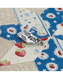 Piedino per patchwork 1/4'' (6,5 mm) con guida